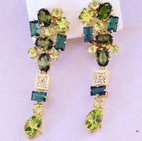 Earrings in gold 18 750, imperial topaz, citrus, aquamarines, garnets and quartz tinted -